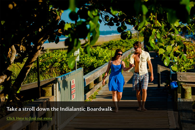 Couple stroll the Indialantic Boardwalk