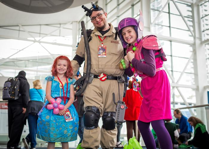 A father and his two daughters in costumes at Denver Comic Con