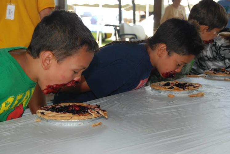 Saratoga Co. Fair two boys participating in the pie eating contest