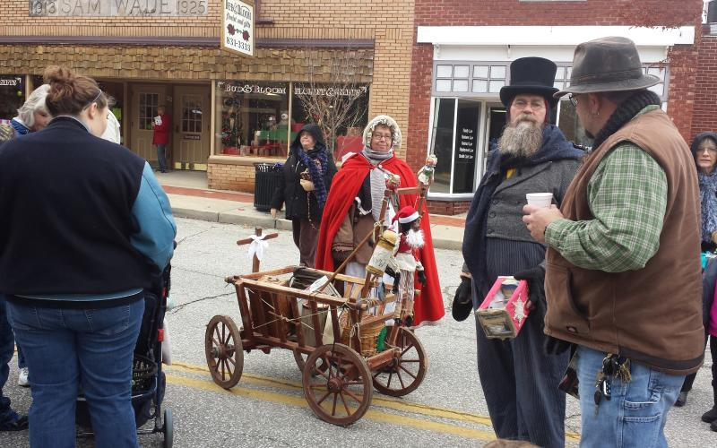 Victorian characters on the street at Mooresville's Victorian Christmas Celebration.
