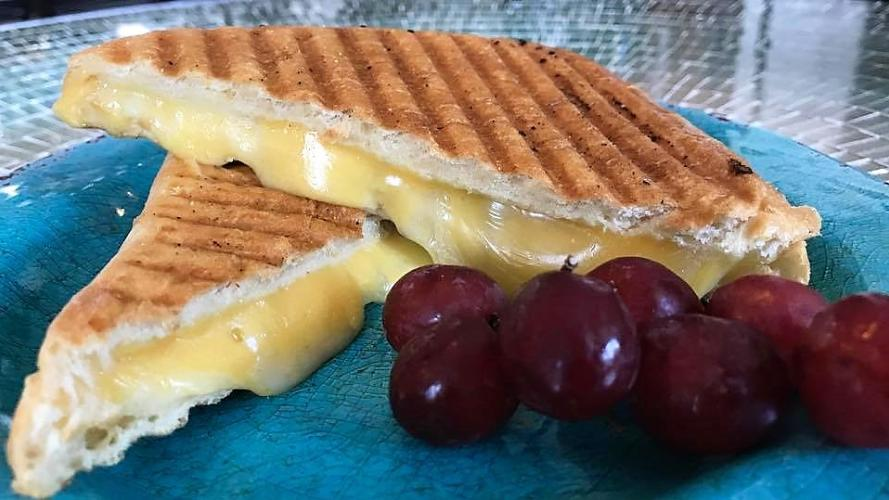 Blue Peacock Bistro plate with grilled cheese and grapes