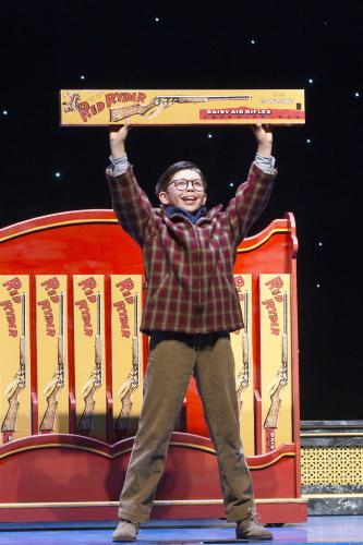 Boy holding Red Ryder BB Gun in the Christmas Story, Broadway Grand Rapids.