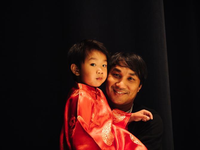 Father and son prepare for performance at Wichita Asian Festival in Wichita KS