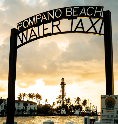 Sign in front of the water for the Pompano Beach water taxi