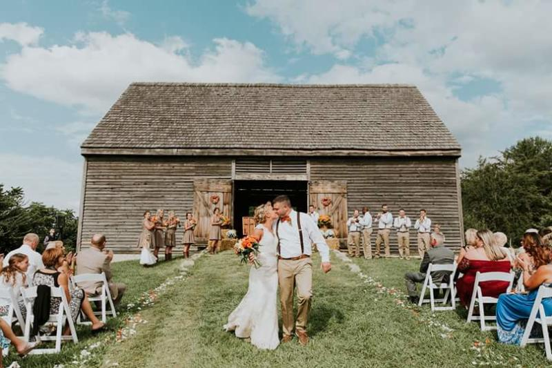 Couple Walking Down the Aisle for their Outdoor Wedding at Howard County Conservancy
