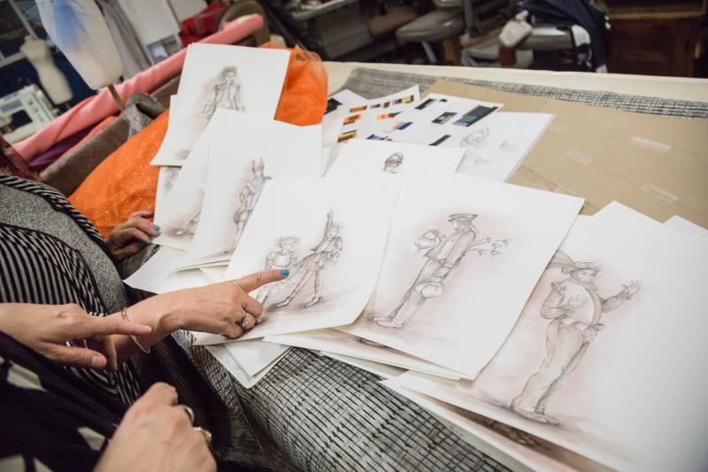 Costume designer Helene Siebrits and her team look over sketches for Tantrum Theater's production of A Midsummer Night's Dream