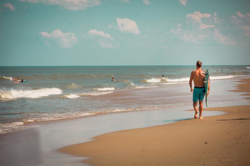 Surfing surf waves surfboard beach resort north end summer vintage northend Ocean Outside Outdoors Man walking action shot