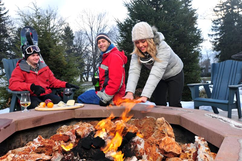 belhurst-geneva-vasiliy-winter-exterior-firepit-warming-hands