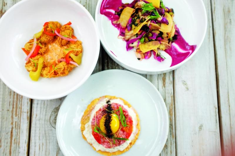 three plates with food at the hightower restaurant in austin texas