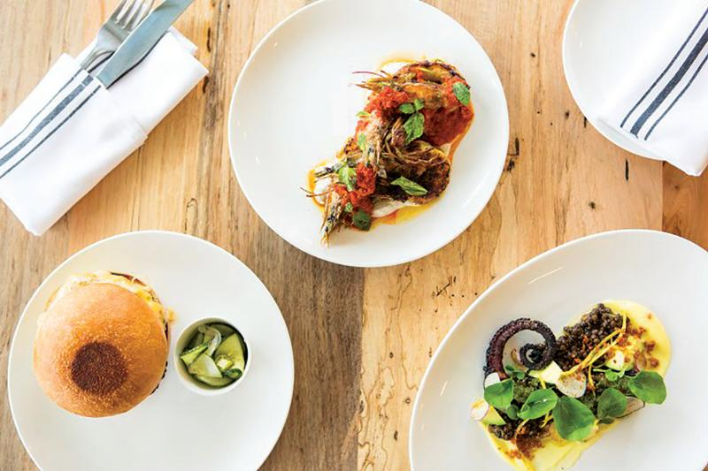 burger and other dishes from launderette restaurant in east austin texas