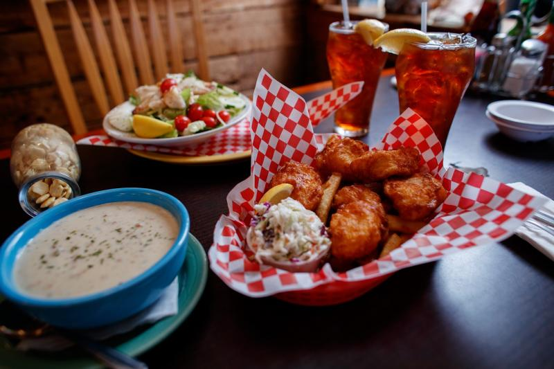 Wally's Chowder and fish and chips on table with iced tea