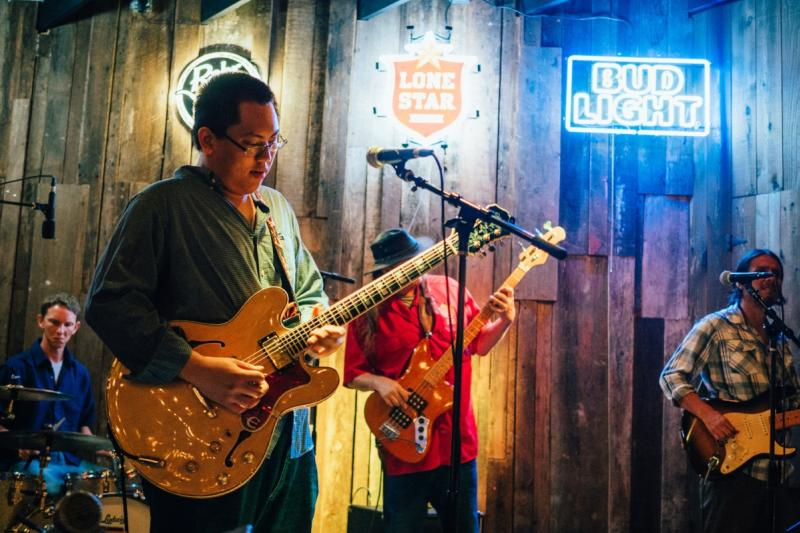 Band on stage at Rustic Tap bar on west sixth street in austin texas