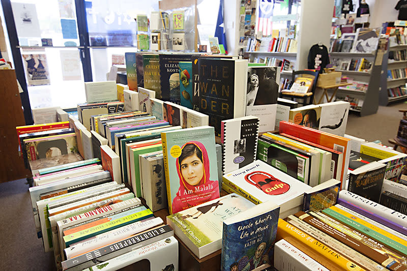 table full of books at bookwoman independent bookstore in austin texas