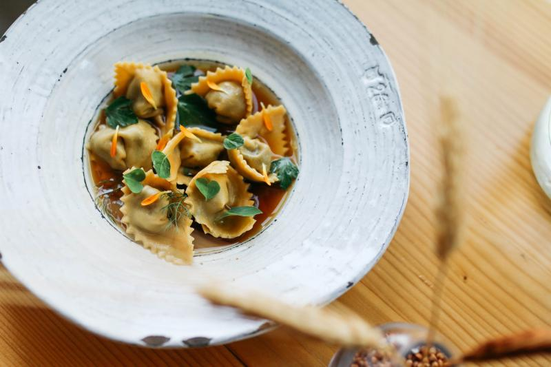 White Sonora Agnolotti Caramelized Onion Beef Jus and Allium Scape from Emmer and Rye in austin texas