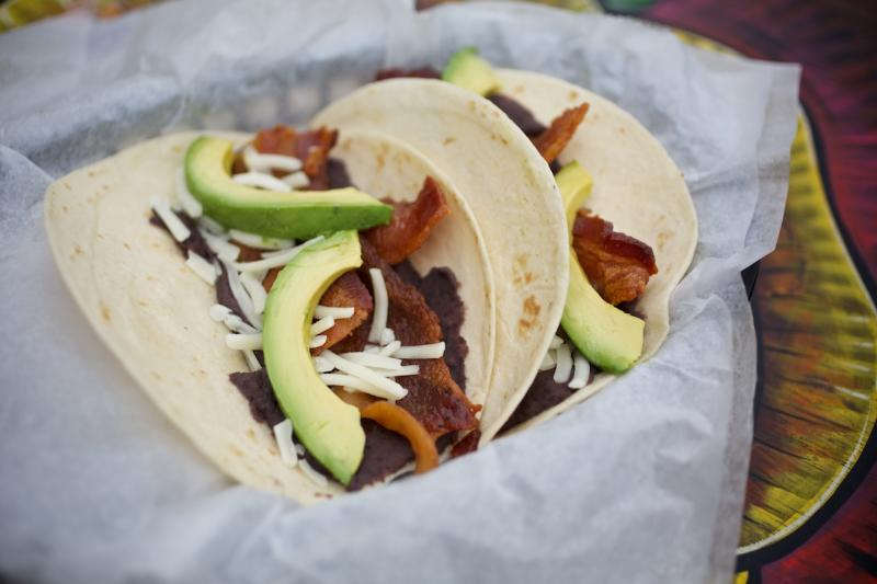 The Otto breakfast taco with bacon cheese avocado and beans from Tacodeli in austin texas
