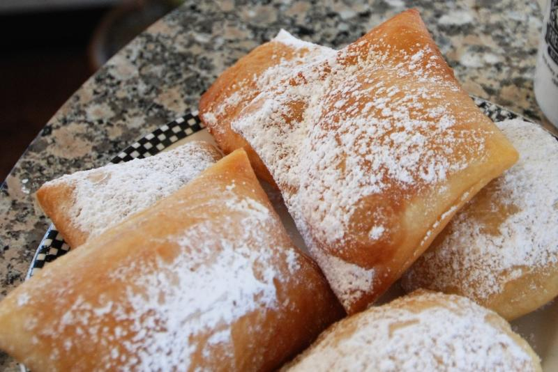 Neignets on a plate at Cafe Du monde in Louisiana