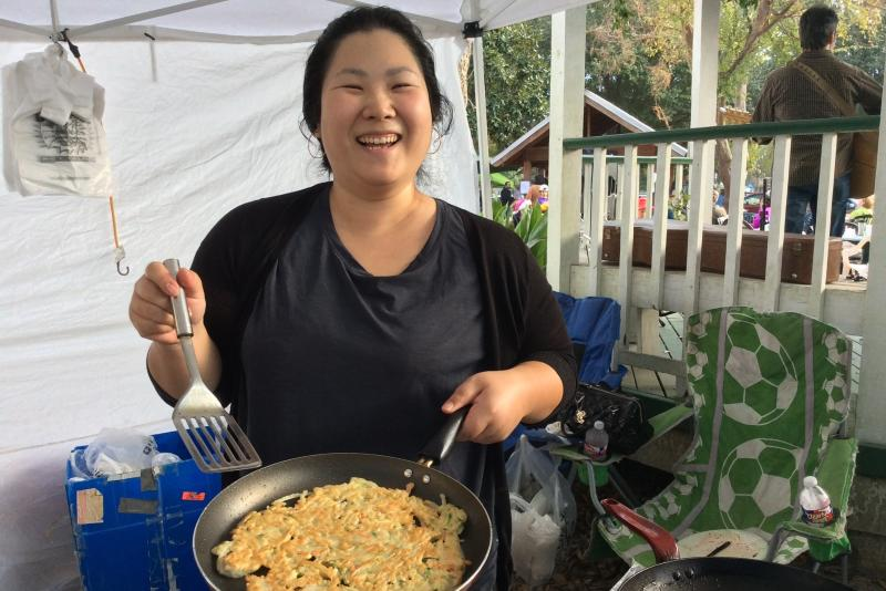 Women making food at Covington Farmers Market