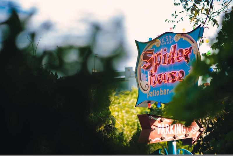 Spider House patio bar neon sign in austin texas