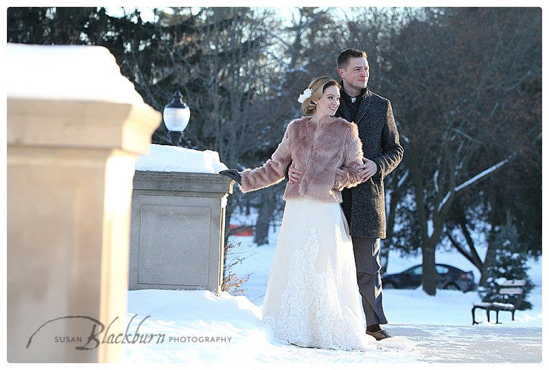 Couple outside on wedding day during the winter with fur coat