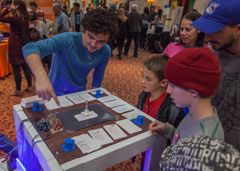 Children participating in interactive activity at Rochester Mini Maker Faire 2017