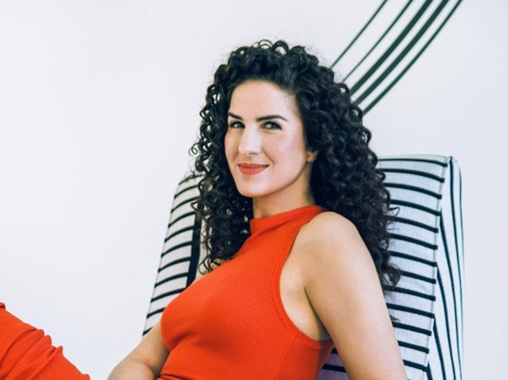 Pianist Laila Biali lounging on a chair