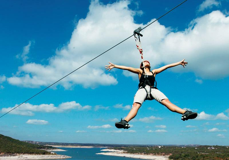 women ziplining with Lake Travis Zipline Adventures in Austin Texas