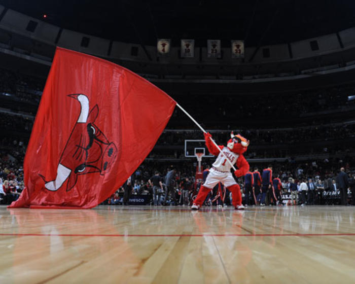 Chicago Bull's mascot, Benny the Bull waving flag