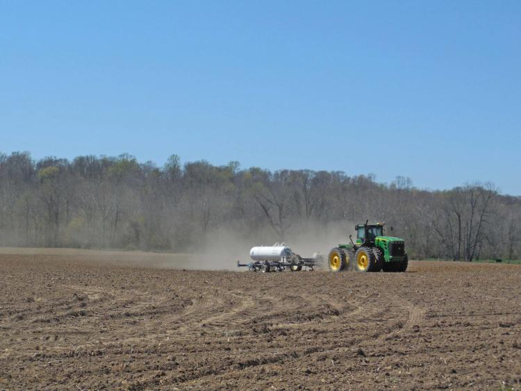 A tractor prepares the spring fields along Bain Road.