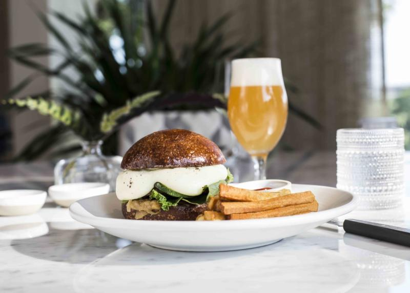 Burger and Fries with beer at Arlo Grey restaurant inside the LINE Austin hotel