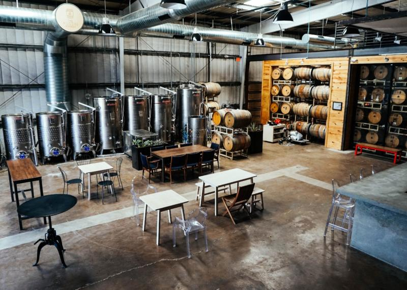 Tasting room and tanks at The Austin Winery