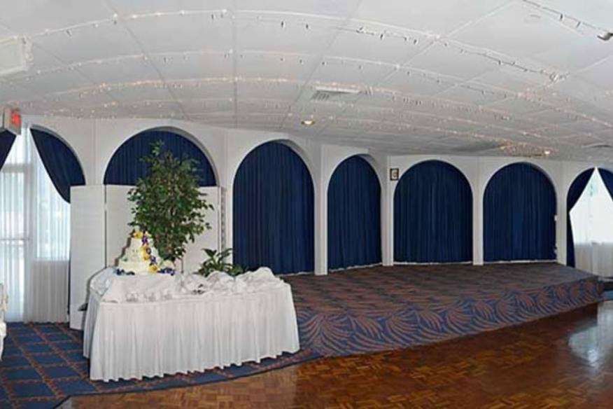 indoor space of lighthouse point yacht & racquet club