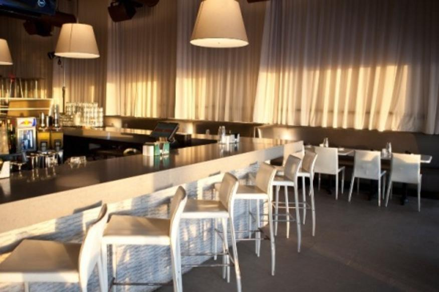 SPAZIO Central Bar features 4 flat panel TV's and a view of the ocean