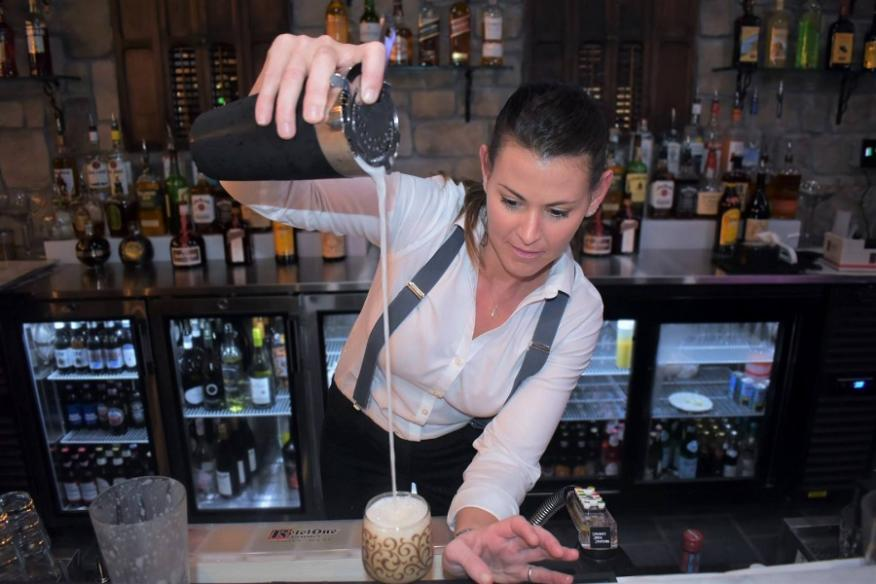 Bartender making craft cocktail