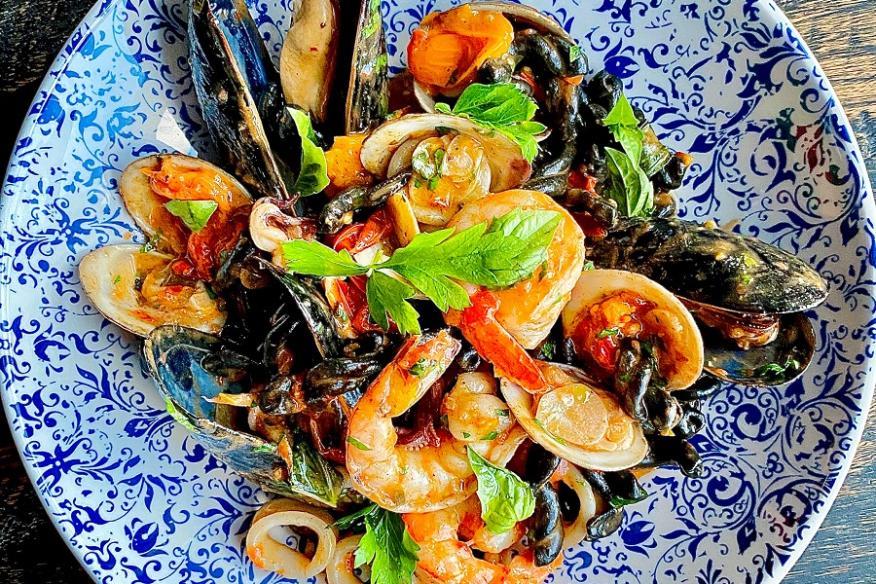 Squid ink Pasta, clams, mussels, shrimp, calamari, lobster uni pomodoro