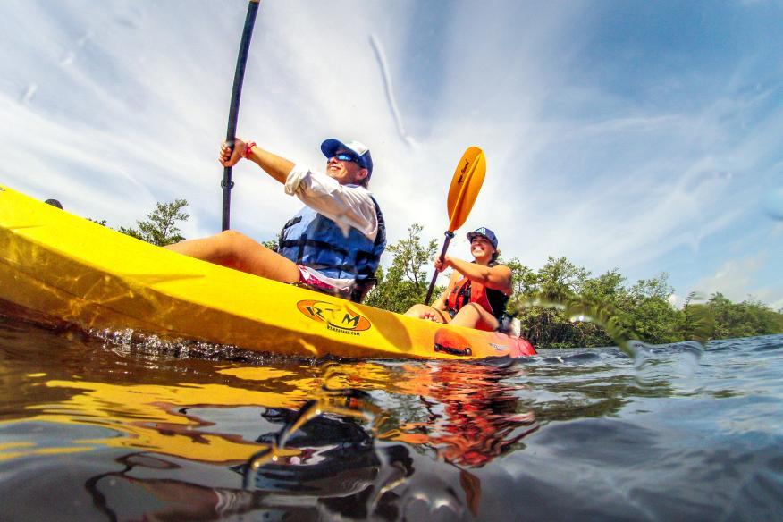 Two girls kayak