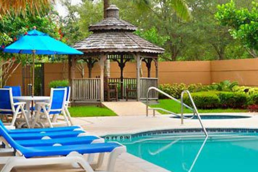 Our Outdoor Pool And Gazebo Offers You A Relaxing Stay At This Coral Springs FL Hotel.
