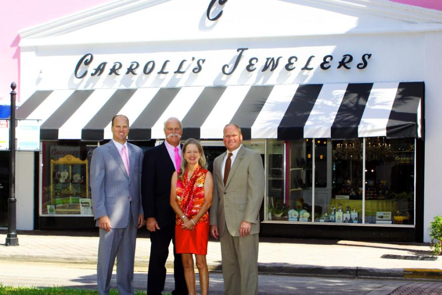 carroll's jewelers staff standing in front of restaurant.