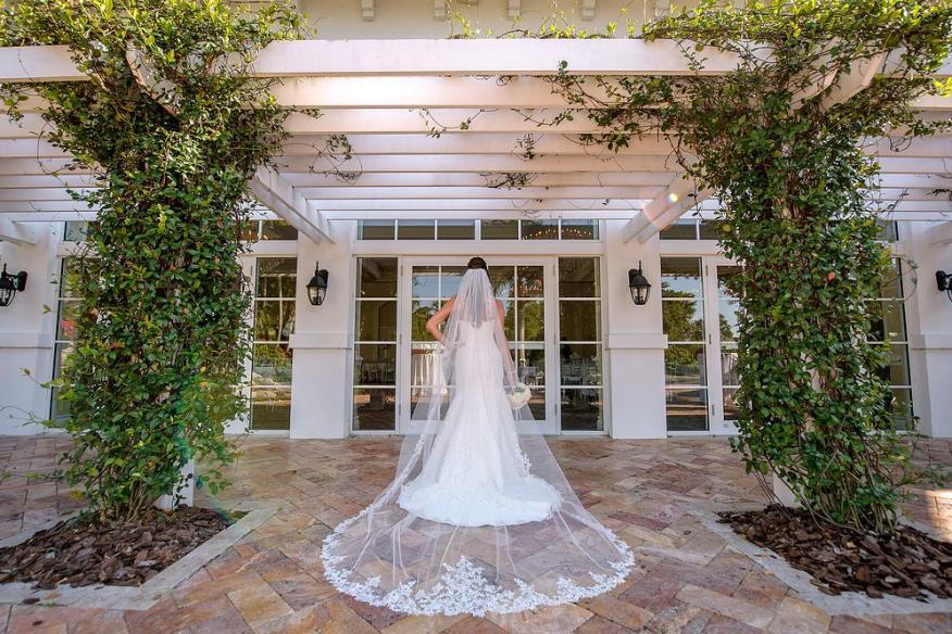 bride in front of french doors
