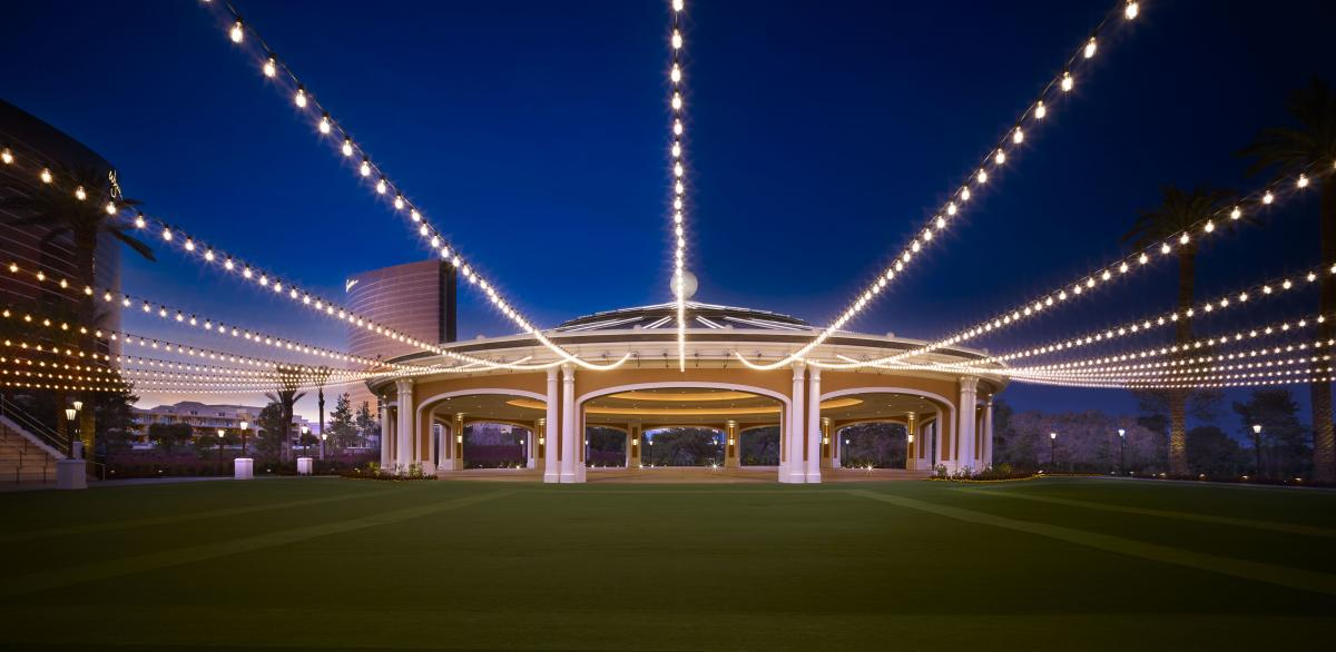 The Event Pavilion at Wynn Las Vegas is a well-lit outdoor meeting space with a sprawling lawn.