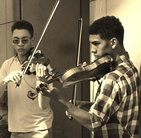 Two young men play their violins at Bunkerfest 2017.