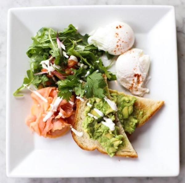 Vino & Vinyl's Hot Smoked Salmon Plate - Served with avocado toast, arugula salad tossed in balsamic vinaigrette, and two poached eggs.