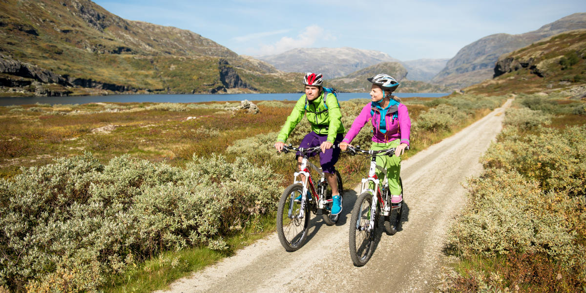 Two people cycling along the Rallarvegen Navvies' Road in Fjord Norway, one of Norway's top 13 scenic bike rides