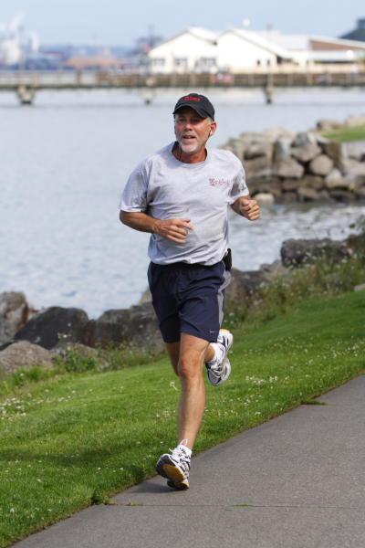 Man Running along Ruston Way Waterfront