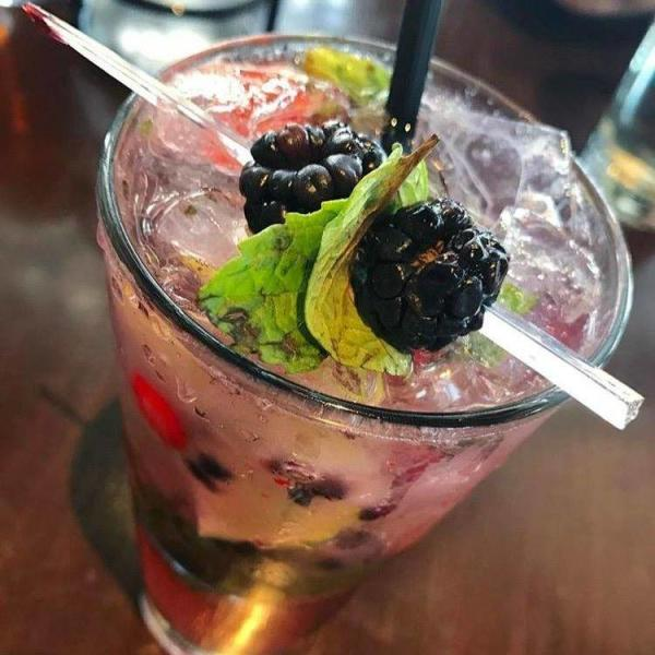 Bar Louie's Berry Mojito garnished with blackberries and mint leaves