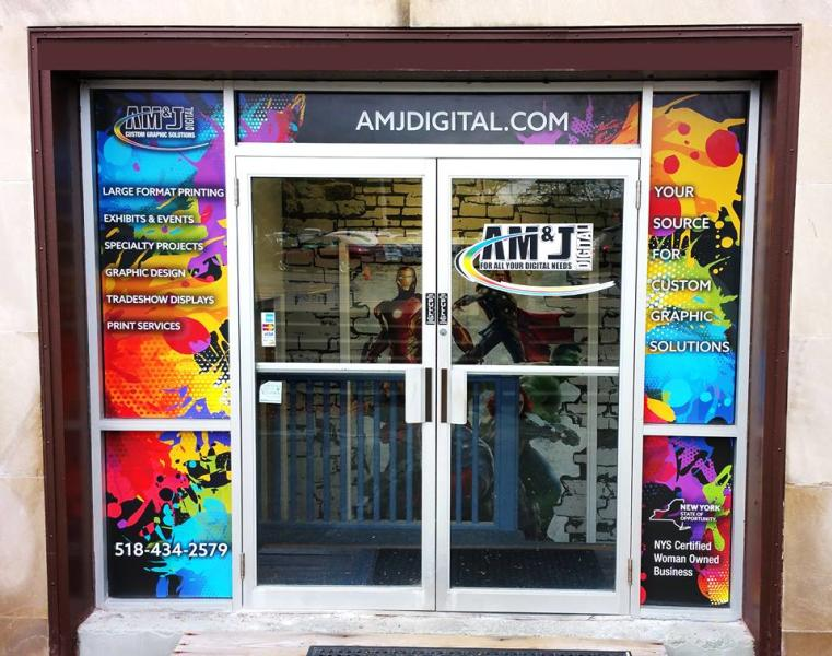 Colorful signage at AM & J Digital entryway
