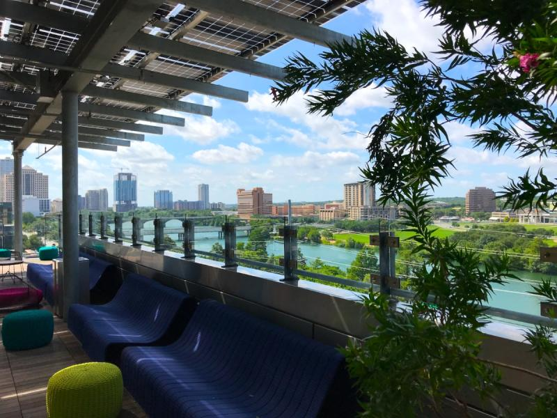 Austin Central Library Rooftop reading spaces with view of Lady Bird Lake during summer