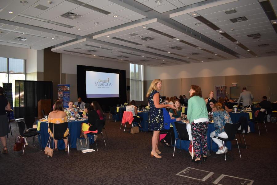 Group sitting for Discover Saratoga presentation at Saratoga Springs City Center