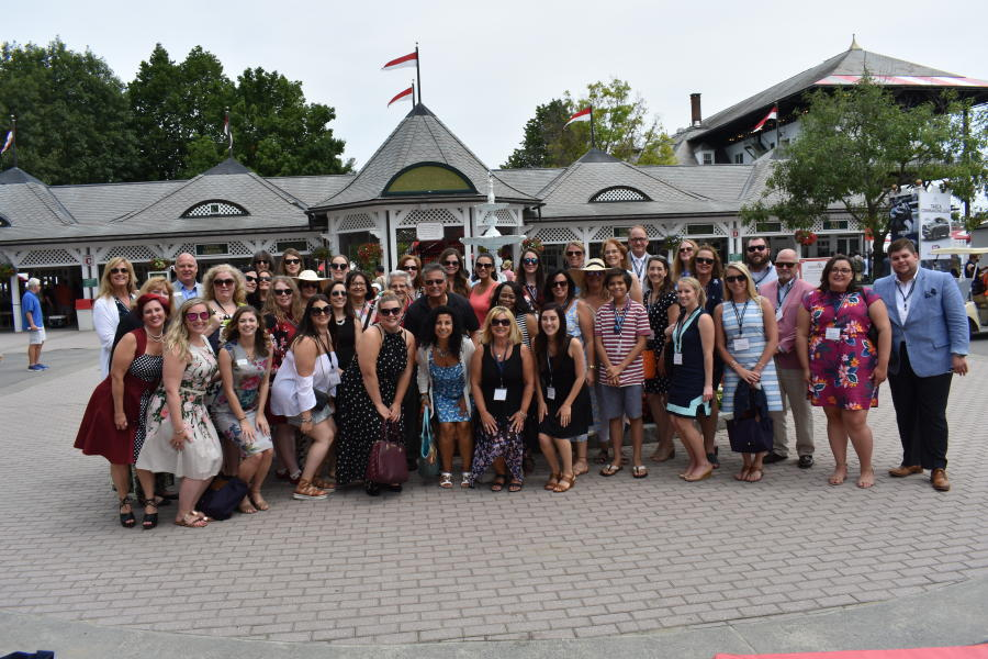Group standing outside Saratoga Race Course entrance