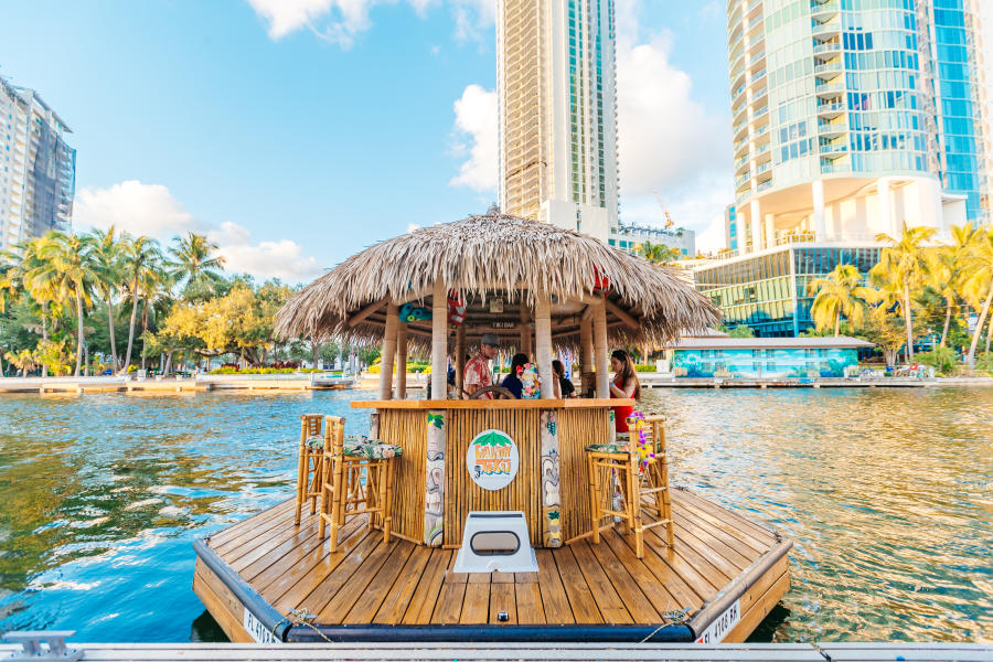 People sitting at the Cruisin Tiki floating bar in Fort Lauderdale