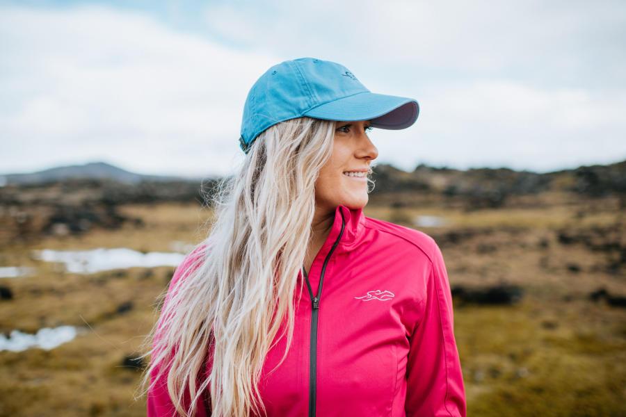 Woman wearing EMBRACE THE RACE hat